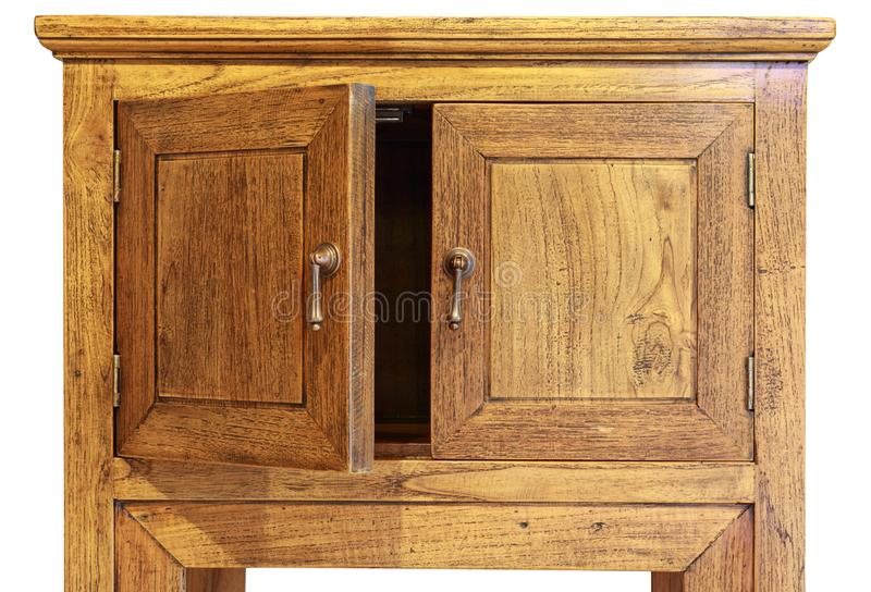 ancient design wooded cupboard isolated on white background, left door opened. stock photo