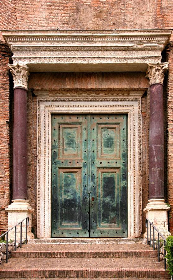 Ancient door. Beautiful ancient door with decorative portal. Rome - the eternal city royalty free stock images