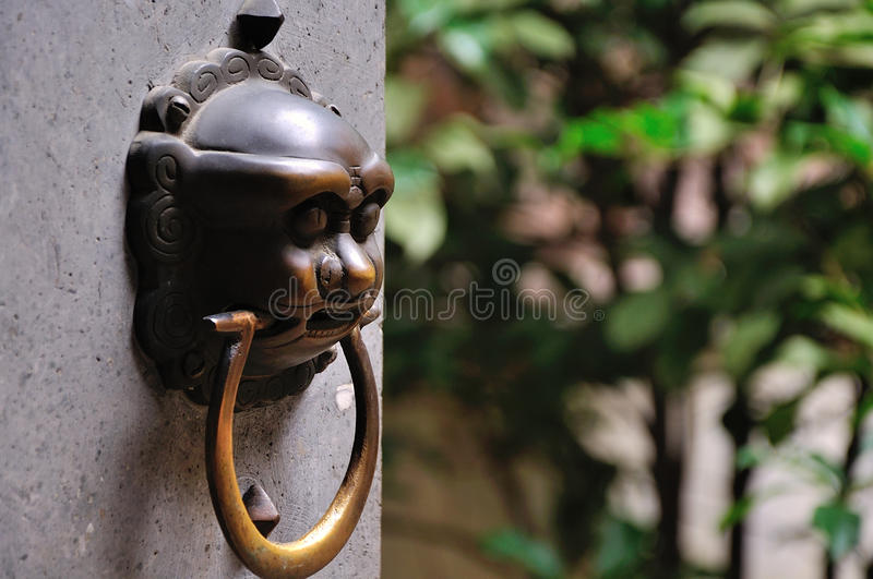 The ancient door bell stock images