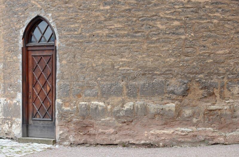 Ancient Door And Brickwall Stock Photo