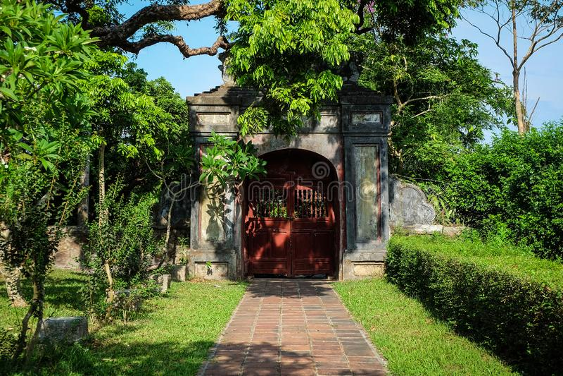 Ancient door in garden of my dream royalty free stock photos