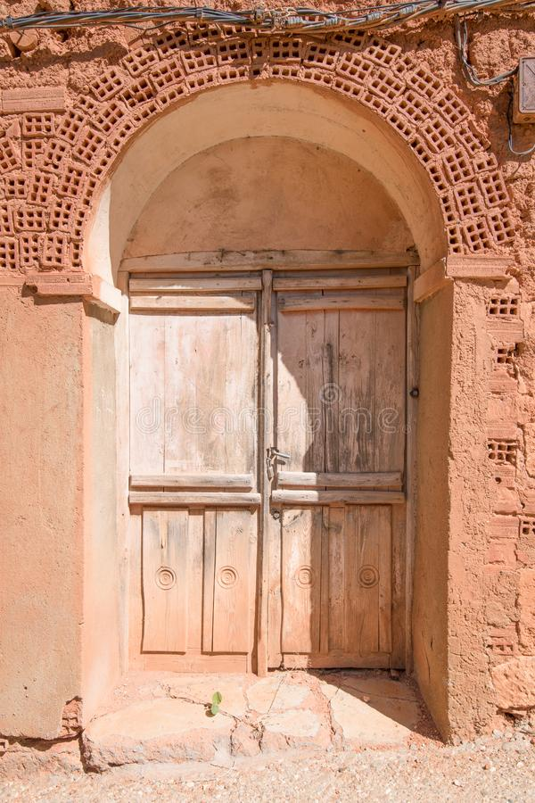 Ancient door of house built with bricks and adobe stock photos