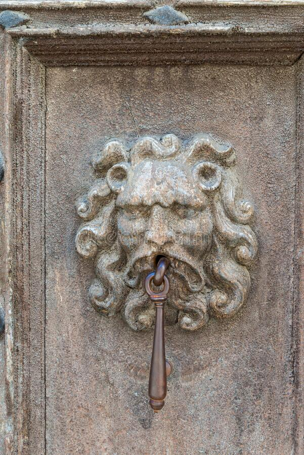 Ancient door with a knocker stock photography