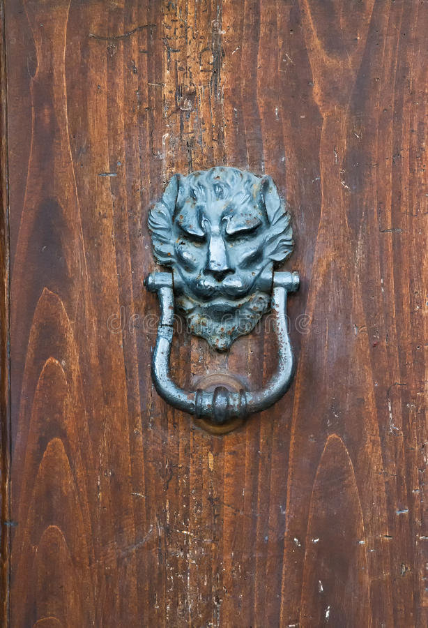 Ancient door knoker with lion royalty free stock images