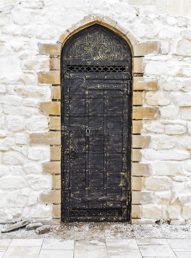 Ancient door in the oriental style stock photos