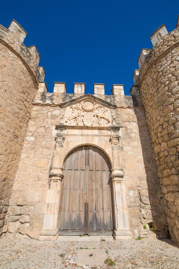 Ancient door of wall in Penaranda de Duero village stock image