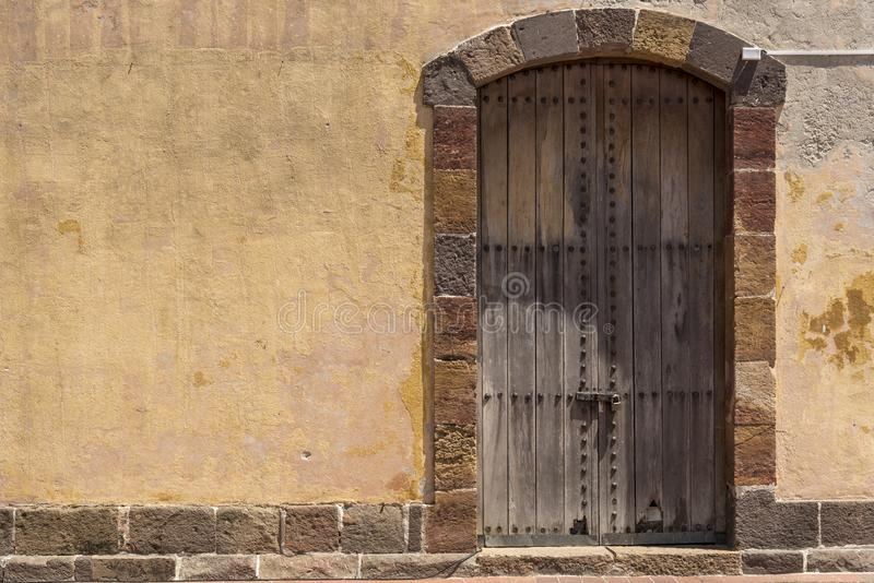 Ancient door and wall in the Plaza de Francia Old Town Panama City Panama. Panama City, the capital of Panama, is a modern city framed by the Pacific Ocean and royalty free stock photo
