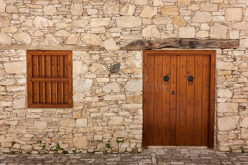 Ancient door and windows on a stone wall stock photography