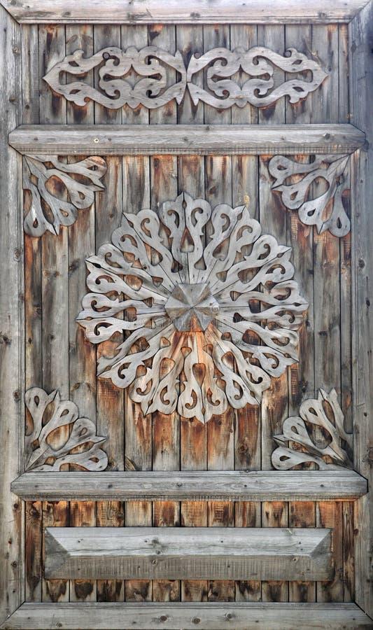 Ancient doors. Old wooden door with a groove stock image