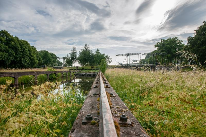 Ancient draw bridge and old locks complex in the Netherlands stock images