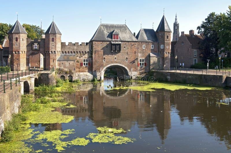 Ancient Dutch city gate Koppelpoort in Amersfoort. The Netherlands, Utrecht province, city Amersfoort: the water and land gate the Koppelpoort. The river Eem stock images