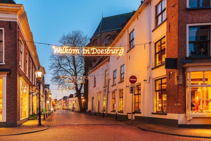 Ancient Dutch street with christmas decoration in Doesburg. Ancient Dutch street with christmas decoration and text 'Welcome in Doesburg' in Doesburg, The royalty free stock photo