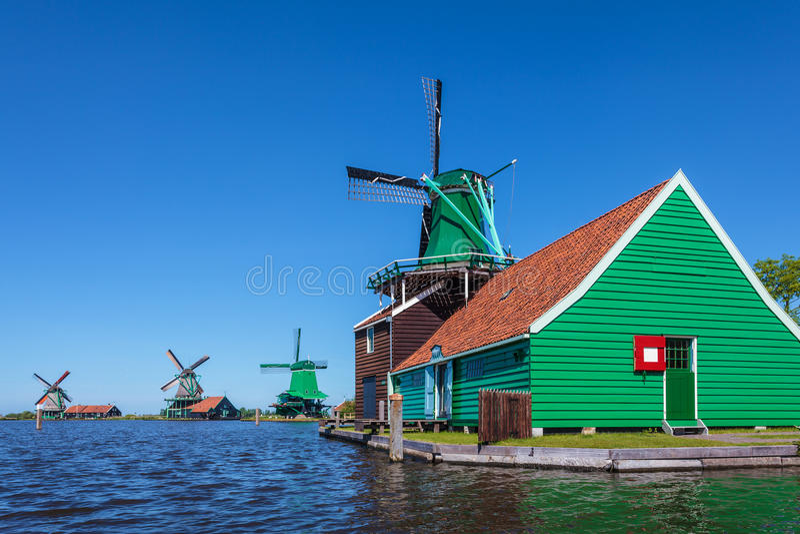 Ancient Dutch wooden windmills at the Zaanse Schans stock images