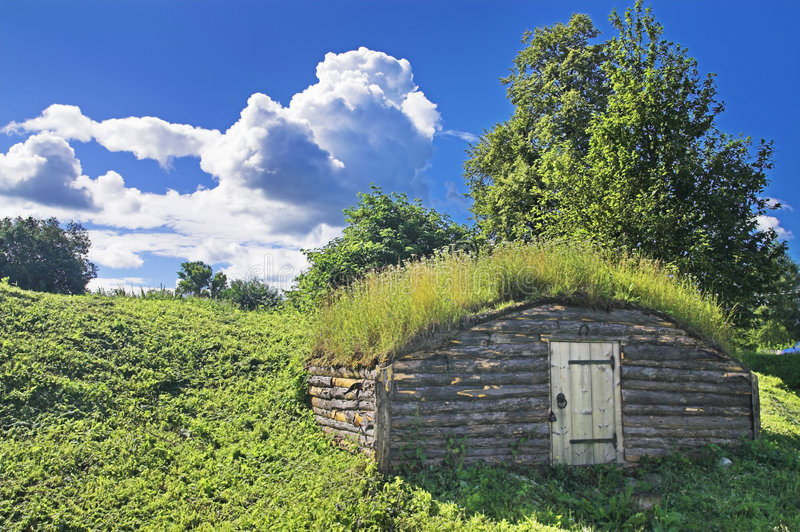 Ancient earth house. Near medieval Russian fortress royalty free stock photos