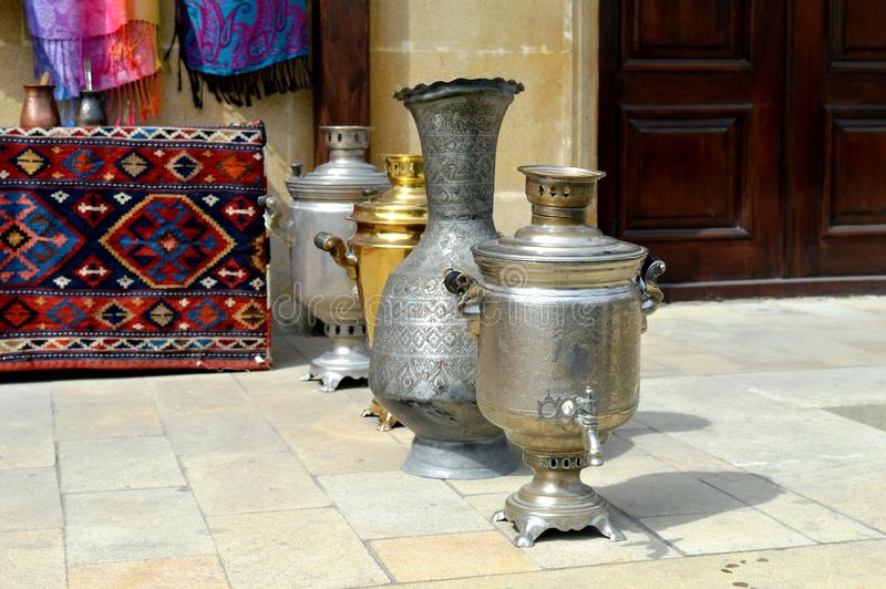 Ancient ecological ware. The picture showsOn a photo are represented ancient iron exotic and ecological ware which use centuries stock photography