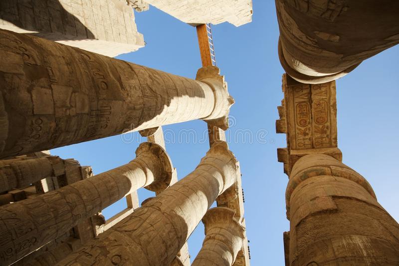 Tourist attraction – Egyptian Temple Complex Karnak. Unesco world heritage in Egypt. Ancient Egypt images and hieroglyphics on wall in Karnak Temple royalty free stock image