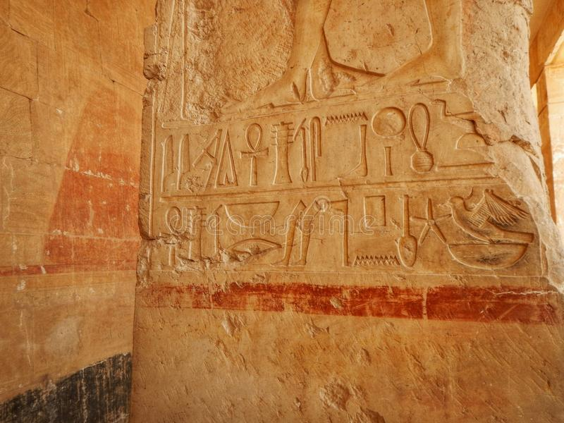 Tourist attraction. Egyptian Temple Hatsepsut – Unesco world heritage. In Egypt. Ancient Egypt images and hieroglyphics on wall in Karnak Temple. In royalty free stock photography