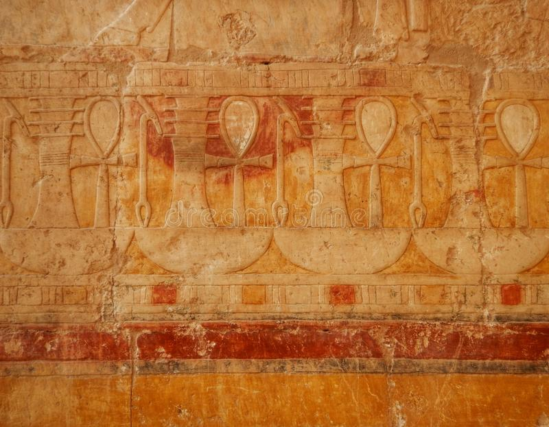 Tourist attraction. Egyptian Temple Hatsepsut. Unesco world heritage – in Egypt. Ancient Egypt images and hieroglyphics on wall in Karnak Temple. In stock photos
