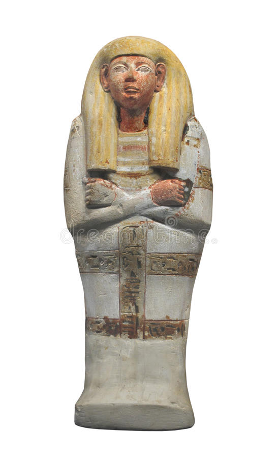 Ancient Egyptian burial figure isolated. Ancient Egyptian clay burial figure for a royal tomb, shaped like a sarcophagus stock image