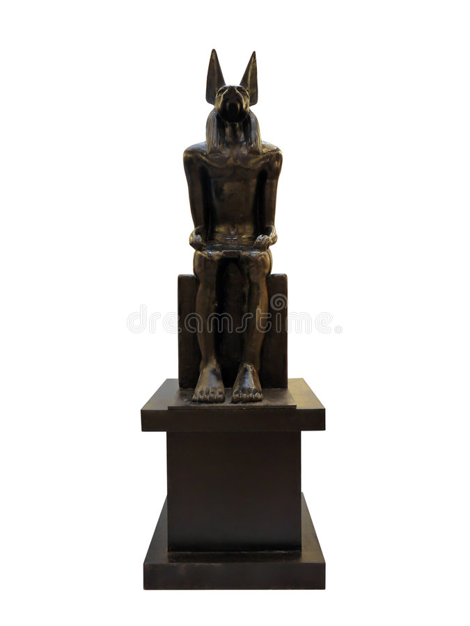 Ancient Egyptian god Anubis. Statue of Anubis - ancient Egyptian god associated with death. Shot isolated on white royalty free stock photo