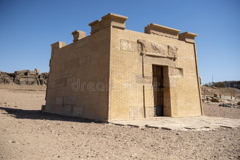 Ancient Egyptian Grave, bas-reliefs with images of people, kings, pharaohs, gods and signs on a stone wall in Aswan royalty free stock photography