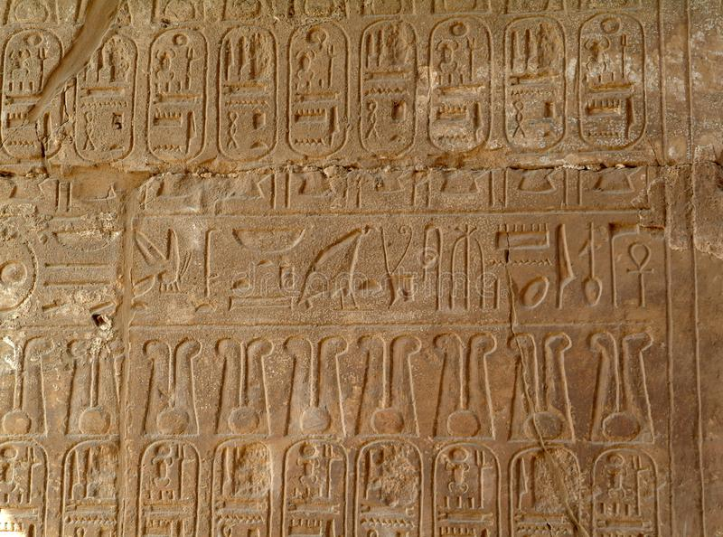 Ancient Egyptian hieroglyphs on the wall of Luxor Temple, without people, Thebes, UNESCO World Heritage Site, Egypt, North Africa royalty free stock photography
