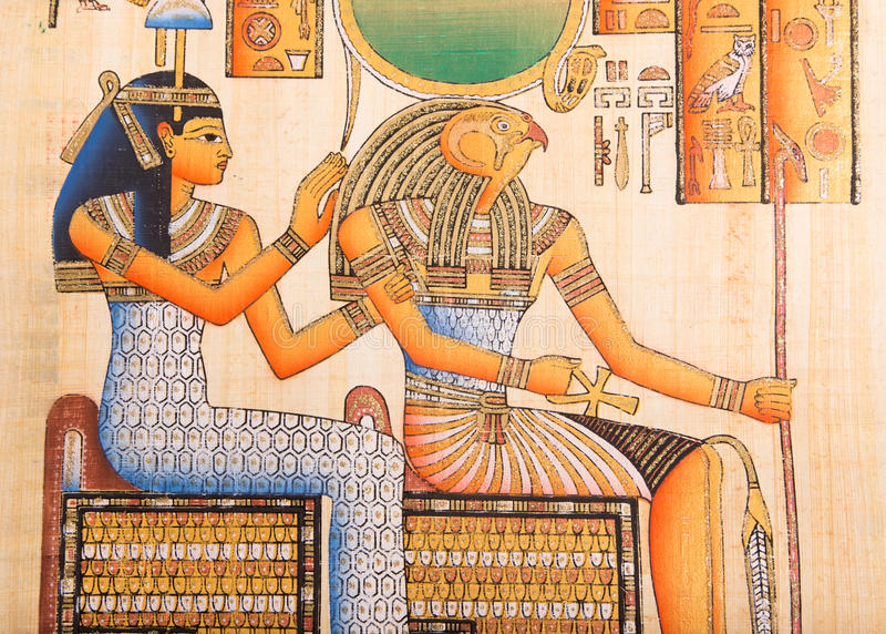 Ancient Egyptian papyrus. Ancient Egyptian God Horus with Queen Cleopatra hand painting on papyrus royalty free stock photo