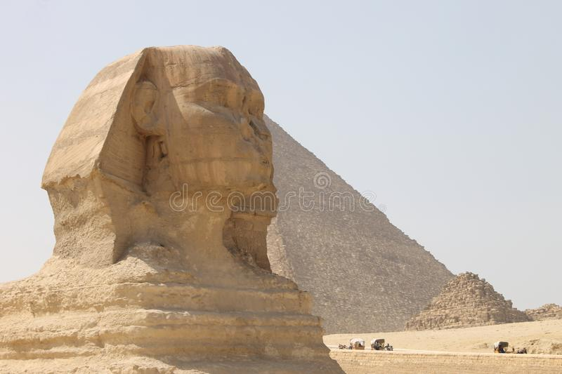 Ancient Egyptian Sphinx and Pyramid of Cheops in Giza stock photography