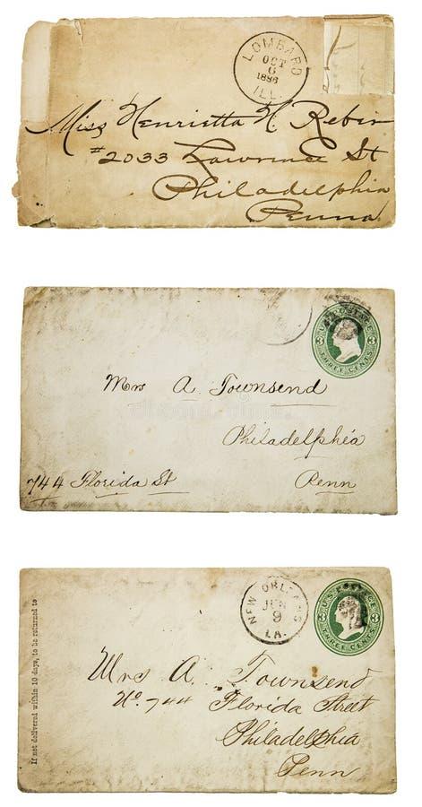 Ancient envelopes stamped 1886 postmark collage. Vintage old envelopes cursive written address stamped ancient 1886 postmark weathered yellowed faded grunge stock images