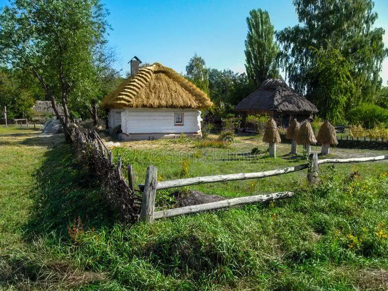 Ukraine, Pyrohiv Kiev - September 17, 2017: Ukrainian traditional rural house with white walls and a thatched roof on a backgrou royalty free stock photo