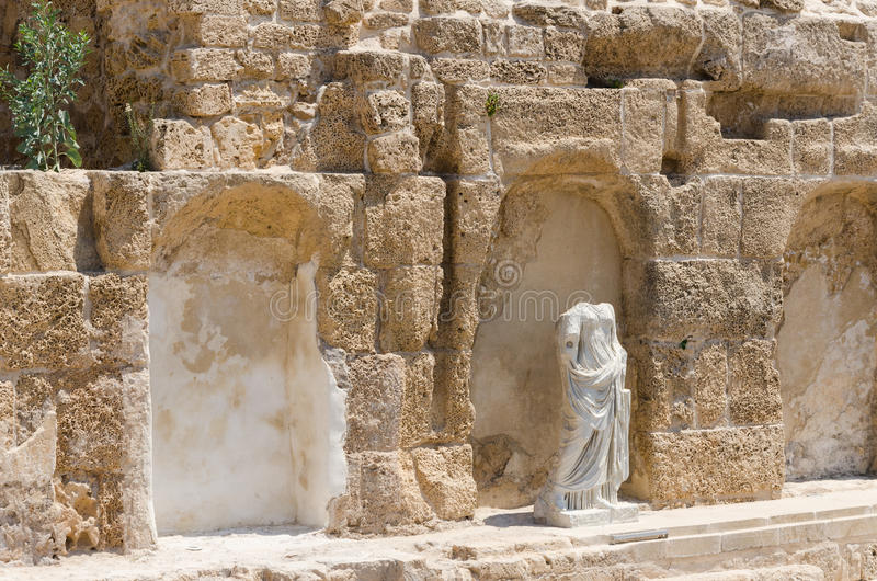 Ancient female sculpture in ancient park in Caesarea, Israel. ISRAEL -July 30, - Ancient female sculpture in ancient park in Caesarea, against the wall. Israel stock photography