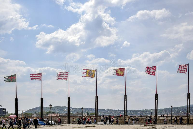 Ancient flags fluttering in the wind on background of blue cloudy sky stock photography