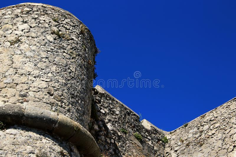 Ancient fort castle building stone wall and tower. On blue sky background, historic, majestic, hill, monument, scenic, sunny, culture, europe, france, nice royalty free stock images