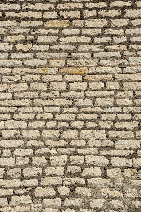 Ancient fortress stonewall masonry background stock photo