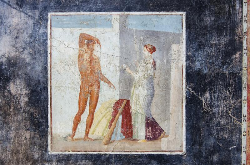 Ancient fresco of Hercules in Pompeii house. Ancient fresco of Hercules on a black background in Pompeii house, Pompeii was destroyed by the eruption of the stock image