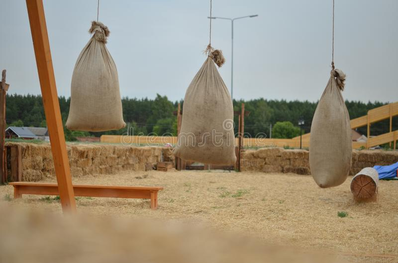 Ancient fun with straw bags royalty free stock photography