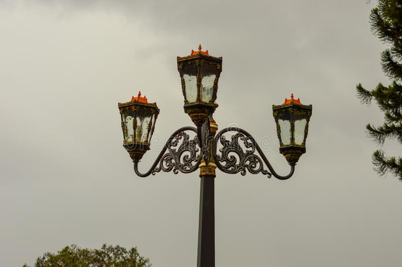 Ancient garden lights with cloudy sky royalty free stock photo