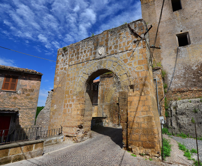 Ancient gate of Faleria. Medieval gate with old noble emblem of the ruined walls of of Faleria, a small town near Rome stock photos