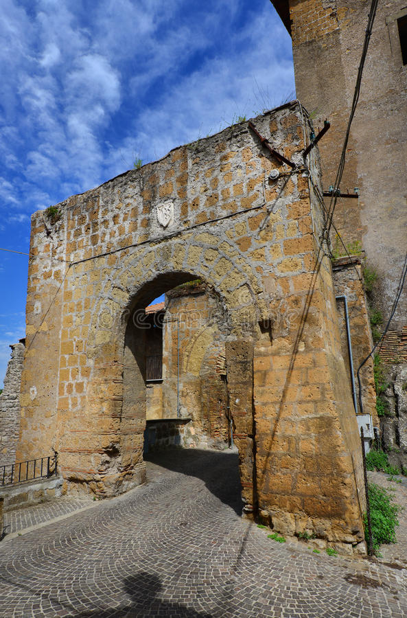 Ancient gate of Faleria. Medieval gate with old noble emblem of the ruined walls of of Faleria, a small town near Rome stock photography