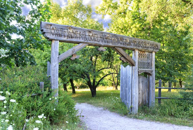 The ancient gate to the ancient Ukrainian Cossack settlement with the inscription My help is from God, who saves the righteous in stock photos