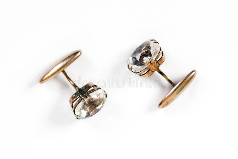 Ancient gold cuff links with rock crystal. Ancient gold men`s cuff links with rock crystal are isolated on a white background stock photography