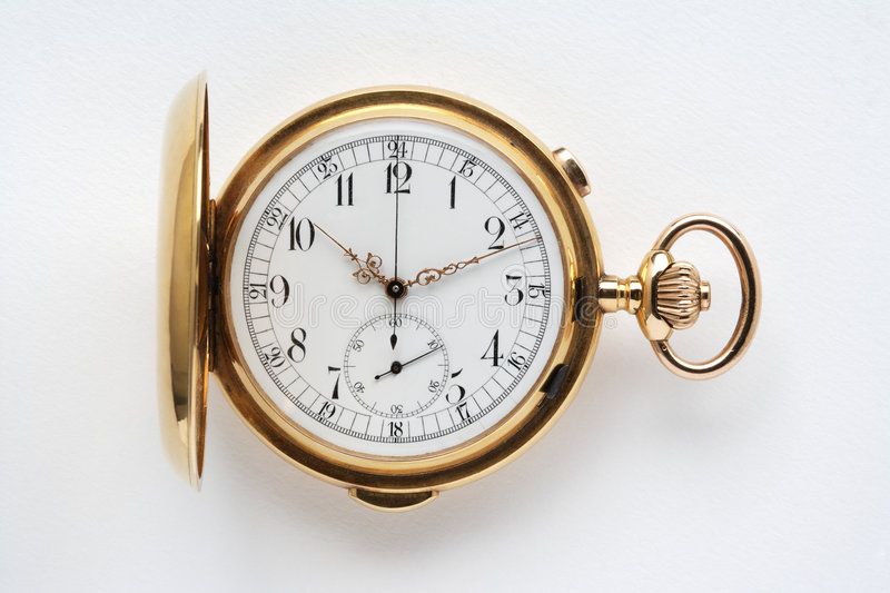 Ancient gold pocket watch. An ancient gold pocket watch background isolated stock image