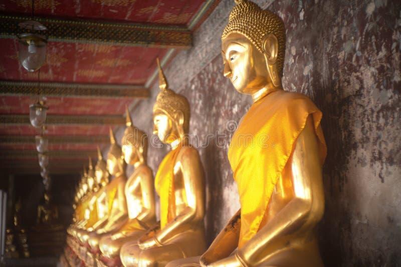 Ancient golden buddha state at Wat Suthat ,Bangkok ,Thailand stock images