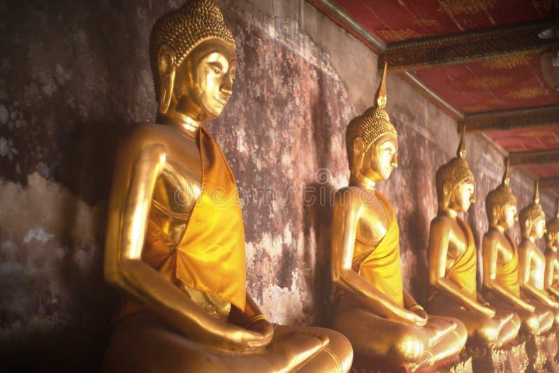 Ancient golden buddha state at Wat Suthat ,Bangkok ,Thailand stock photography