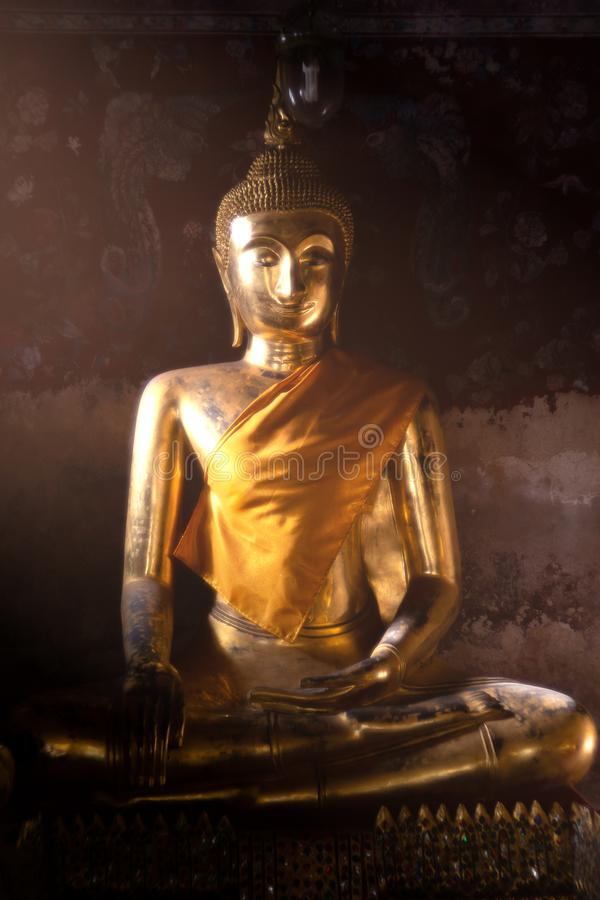Ancient golden buddha state at Wat Suthat ,Bangkok ,Thailand royalty free stock photography