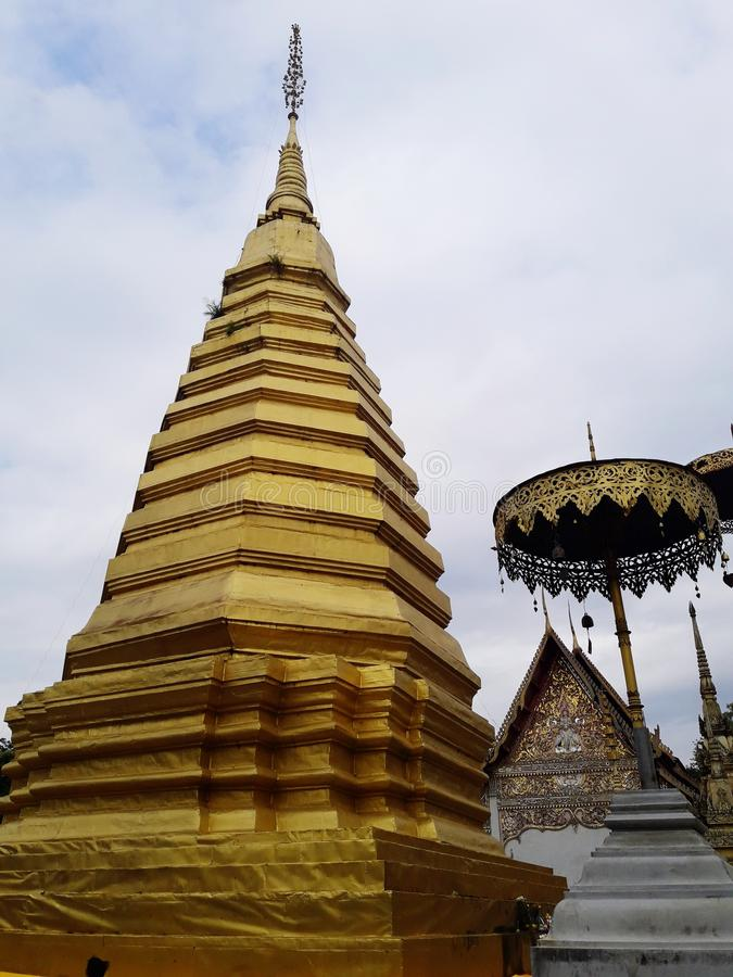 Ancient golden pagoda. In Thailand royalty free stock photography