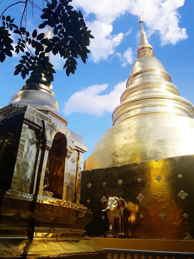 Ancient golden pagoda in Chaing mai, Thailand. Travel, art, temple, buddha, tree, sky, cloud, building royalty free stock images