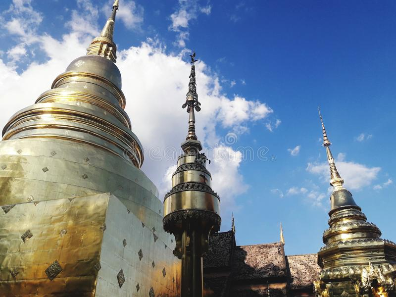 Ancient golden pagoda in Chiang Mai, Thailand. Travel, temple, building, historic, sky, cloud stock photos
