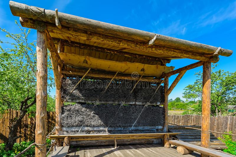 Ancient graduation tower for salt production. Reconstructed ancient wooden graduation tower (thorn house) for removes water from a saline solution by stock photos