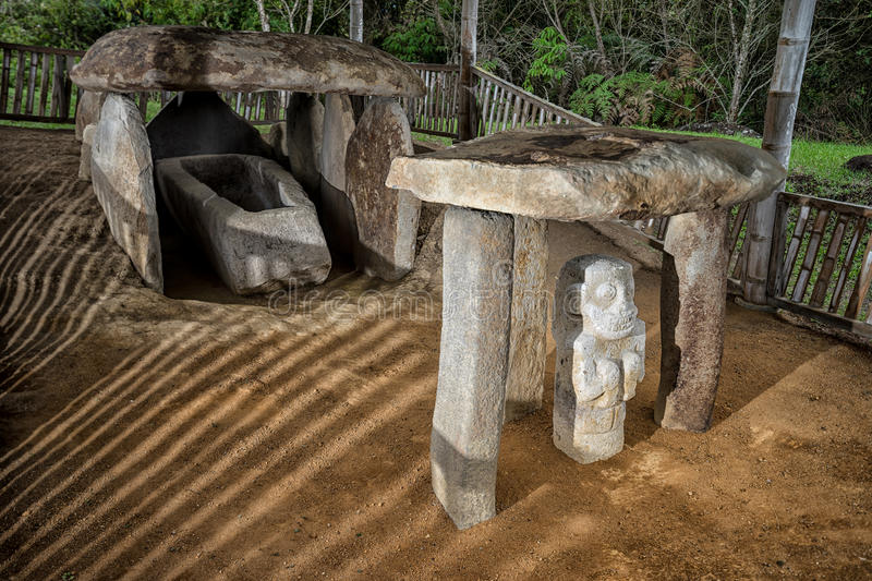Ancient grave in San Agustin Colombia. Ancient pre-columbian tomb in San Agustin Colombia with statue in Altos de los Idolos, San Agustin, Colombia stock photography